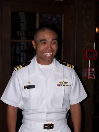 CMDR Romuel 'Roy' Nafarrete, USN greets the bloggers